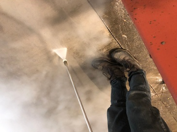 Worker Cleaning a Tile - Pressure Washing Services Strathroy ON by SkyClean Inc.