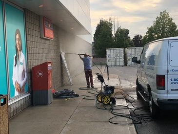 Worker Cleaning a Wall - Pressure Washing Services Sarnia ON by SkyClean Inc.